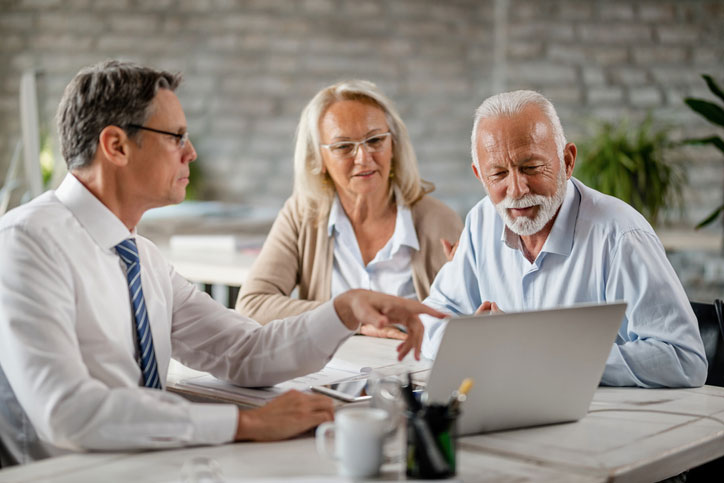 mature couple meeting with accountant