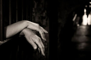 hands in jail cell